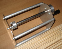 Photo: Potato Spiral sticks next to potato cutter
